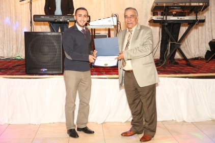 Representative of the Mayor of Patterson presenting a proclamation to Atef Elbeialy
